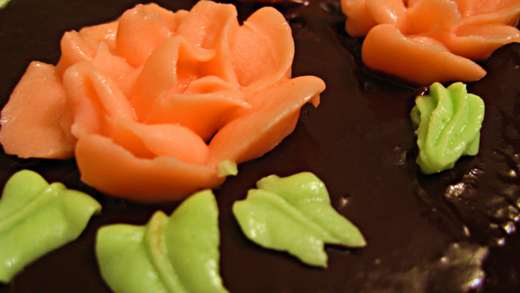 Buttercream flowers will adhere to the surface of chocolate glaze / Photo by E. A. Wright