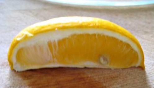 A sliced Meyer lemon