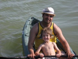 the water is only about a 8 inches deep here. I love this kid.!
