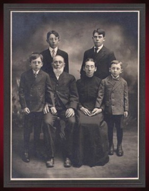 With his natal family, top right.