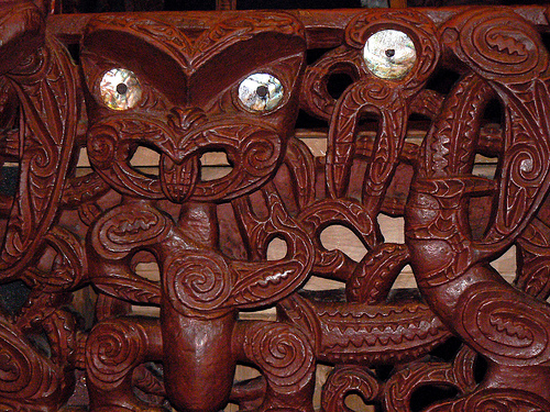 Maori carving with typical paua shell eyes.