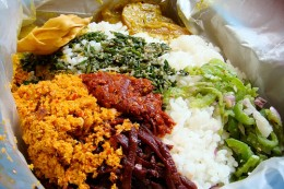 Sri Lankan rice with curry, pickles, sambol and mallung