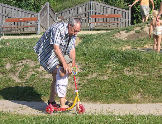 Grandpa agreed to play with his granddaughter and follows through.