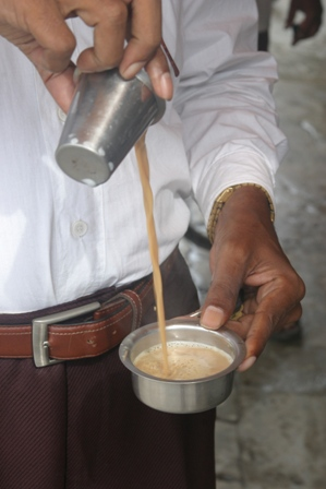 The coffee mixing and pouring in tumbler and glass.