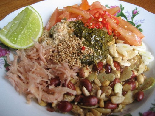 a salad combi of  pickled tea (leaves)and lots of ingredients and dressing, lime included plus sauce of fish