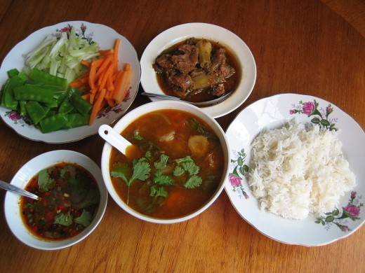 it consists of rice, vegetables, raw and fresh or boiled, soups and curried paste