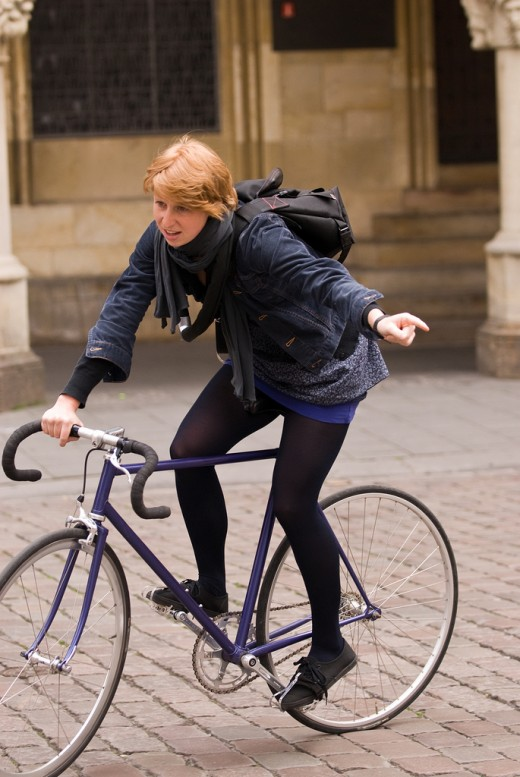 Fashion on a fixed gear bicycle. It works...
