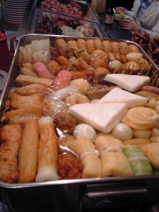 oden mostly seafoods cooked similar in Japan cosisting of meatballs tofu, boiled eggs and radish, pickled