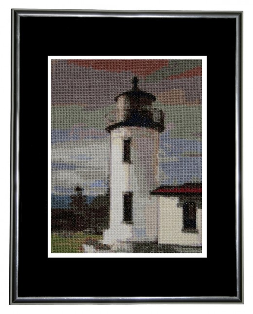 This is the finished Lighthouse pattern framed 11 x 14