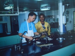 TRAVEL MAN with a Filipino AB while sorting out HUGE SQUIDS, their fresh catch from TALARA, PERU (2003)