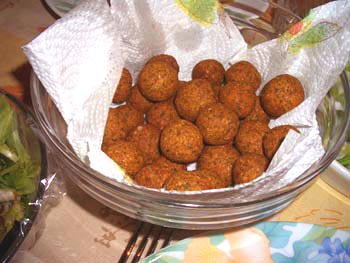 Falafel -- patty which is fried garbanzos, round shaped