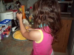 Naomi learned to grate cheese.