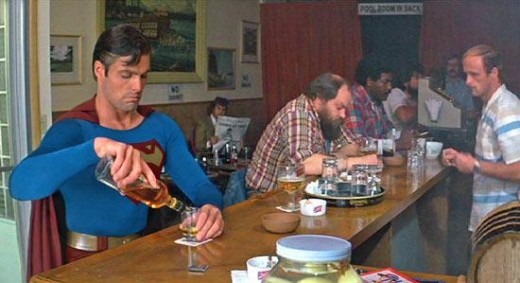 The Evil Superman tipping back some Johnny Walker Red (Superman III).
