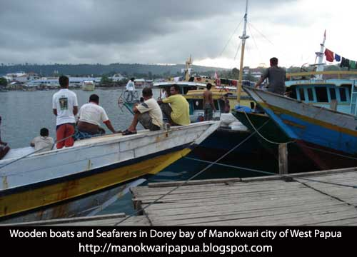 Seafarers and wooden boats in Manokwari city of West Papua, the Republic of Indonesia