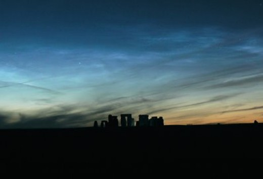 This is another example of noctilucent clouds, again seen near the daylight-darkness terminator. The glow is caused by the photoelectric effect at the blue end of the visible spectrum for hydrogen.