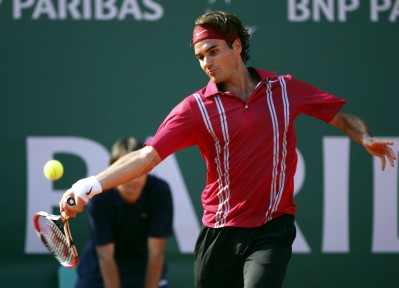 Roger Federer about to hit a powerful forehand shot.