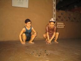 Children at Play in Village Scene