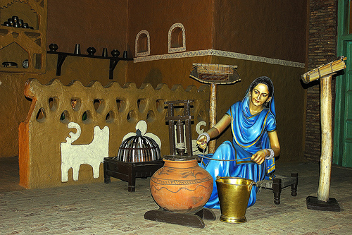 Lady in Village Home Scene