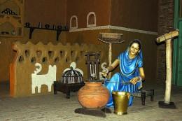 Lady in Village Home Scene