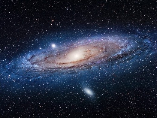 This is the Andromeda Galaxy as we can see it today. Notice that it is slightly warped, a sure sign of past activity of devouring smaller galaxies.