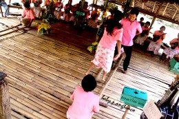 "Performers doing the ""tinikling"" or bamboo dance"