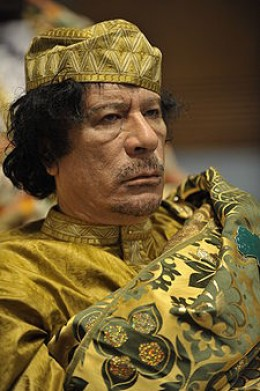 Gheddafi in a beautiful dress