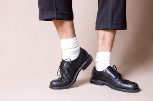 A men wearing white socks. The picture also shows what happens if your socks (no matter what color they are) are too short and you are sitting down. It's better to get longer socks that can go all the way up to your knees!