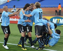 The Uruguay team celebrate Luis Suarez (R) scoring the opening goal during the 2010 FIFA World Cup South Africa Group A match between Mexico and Uruguay at the Royal Bafokeng Stadium on June 22, 2010 in Rustenburg, South Africa. (June 21, 2010 - Phot