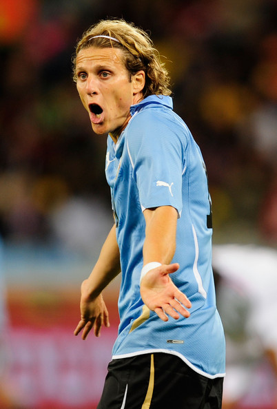 Diego Forlan of Uruguay gestures during the 2010 FIFA World Cup South Africa Group A match between Uruguay and France at Green Point Stadium on June 11, 2010 in Cape Town, South Africa. (June 10, 2010 - Photo by Jamie McDonald/Getty Images Europe)