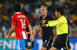 Simon Elliott of New Zealand argues with Cristian Riveros of Paraguay during the 2010 FIFA World Cup South Africa Group F match between Paraguay and New Zealand at Peter Mokaba Stadium on June 24, 2010 in Polokwane, South Africa. (June 23, 2010 - Pho