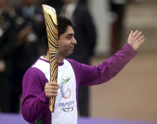 The gold medalist shooter Abhinav Bindra is the first baton bearer