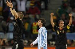 Argentina's Lionel Messi reacts between Germany's Bastian Schweinsteiger (L) and Philipp Lahm (R) after the 2010 World Cup quarter-final soccer match at Green Point stadium in Cape Town July 3, 2010 Photograph by: Marcos Brindicci, Reuters