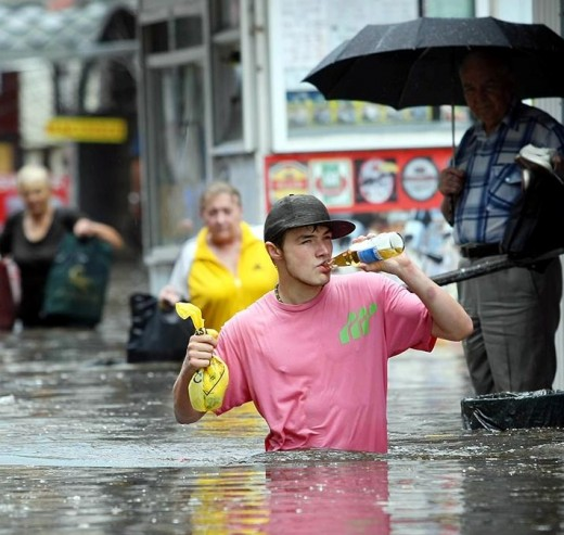 It looks that some Ukrainian guys didnt really care and flood didnt interfere with their favorite snack.