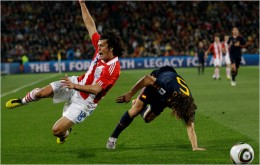 Spain's Carles Puyol, right, competes for the ball with Paraguay's Nelson Haedo Valdez. Photo - Luca Bruno/Associated Press