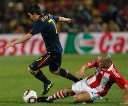 Spain's David Villa, left, controls the ball from Paraguay's Dario Veron during the World Cup quarterfinal soccer match between Paraguay and Spain at Ellis Park Stadium in Johannesburg, South Africa, Saturday, July 3, 2010. (AP Photo/Bernat Armague)