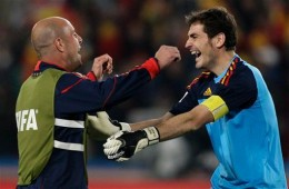 Spain goalkeeper Iker Casillas, right, and Spain goalkeeper Pepe Reina, left, celebrate following the World Cup quarterfinal soccer match between Paraguay and Spain at Ellis Park Stadium in Johannesburg, South Africa, Saturday, July 3, 2010. Spain de