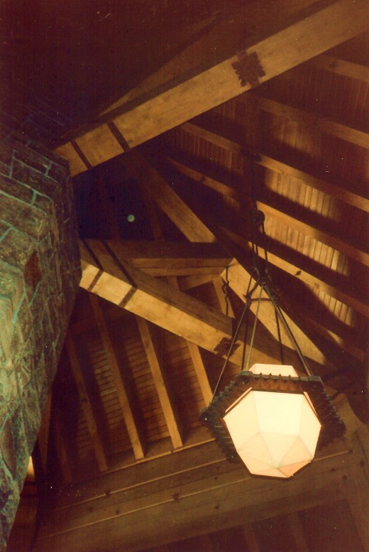 Looking up at the ceiling beams and handcrafted lighting fixtures
