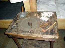 A dining table with a soldier's items.  Photo by Gerber Ink.