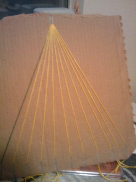 Put all of the strings into their own slit. putting the background colored string into the slit all the way to the left.