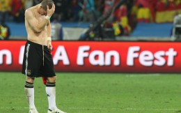 Bastian Schweinsteiger walk off the field at the end of the match between Germany and Spain July 7 in South Africa world cup action