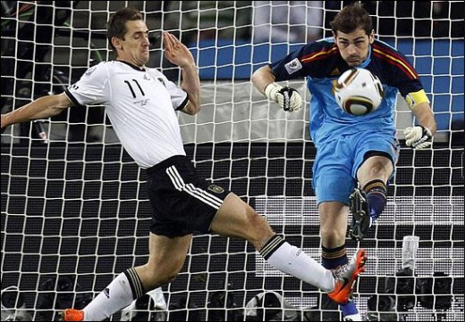 WC Semi Finals goalkeeper Iker Casillas is rushed into a clearance by the on-rushing Miroslav Klose Picture: AP