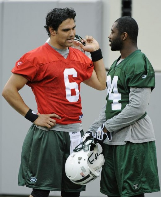 New York Jets' Mark Sanchez, left, talks with Darrelle Revis during football practice at the new Meadowlands Stadium Wednesday, June 16, 2010 in East Rutherford, N.J. (AP Photo/Bill Kostroun)
