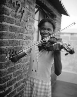A young violinist from Soweto. Photo from the BuskAid Facebook site.