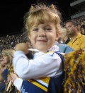 My daughter several years ago in her LSU cheer outfit enjoying her first game.