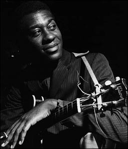 Grant Green smiling after another killing session.