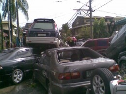 Cars parked in front.