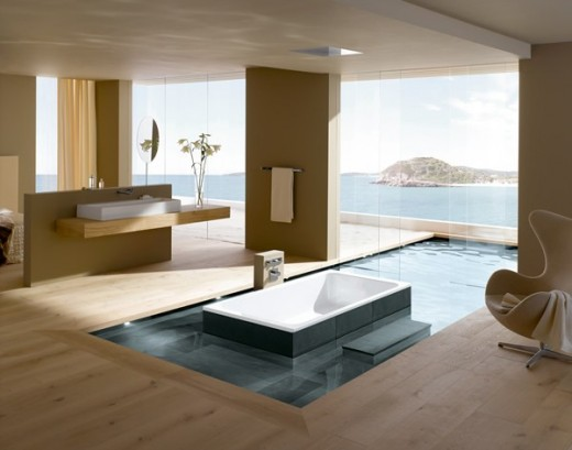 This is an awesome luxury bathroom! Spectacular view, not to mention the seemingly floating tub surrounded by a shallow pool that continues on to the outside....with- the huge ocean view!