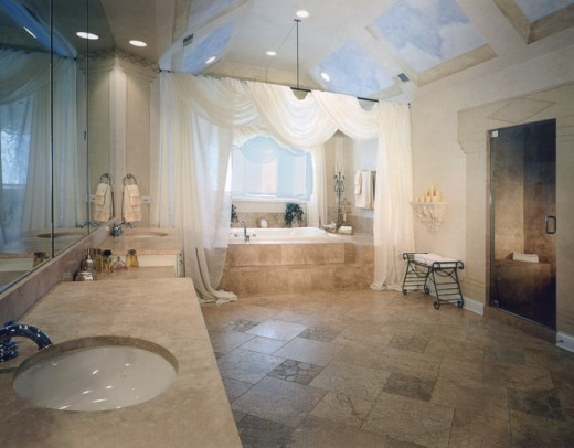 Wow, loving the huge open area in this bathroom. Great sky lighting and the drapes are elegantly placed framing the tub.
