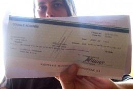 Me in South Africa, holding my 3rd Google Adsense cheque.