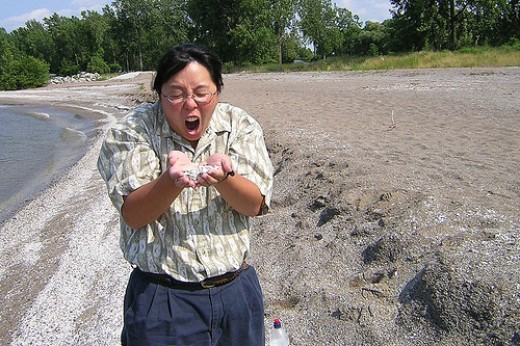 Here a shocked biologist holds the culprit that wiped out whole ecosystems in a single year,
